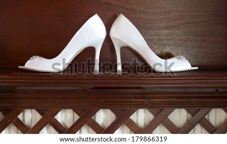 Arrangement of brides shoes - stock photo