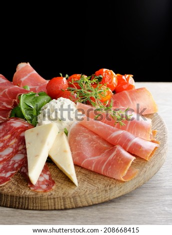 Arrangement of Delicatessen Cold Cuts with Smoked Ham, Cheese ,Pepperoni, Salami... - stock photo