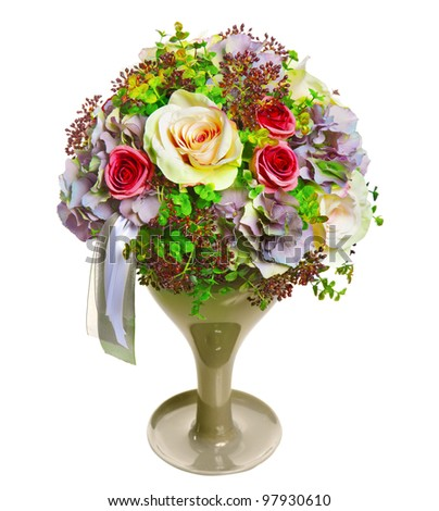 arrangement of flowers and ribbons in a glass vase - stock photo