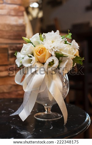 Arrangement of flowers in a vase - stock photo