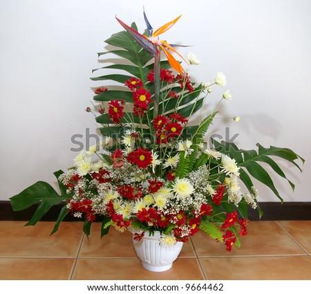 arrangement of flowers in vase - stock photo