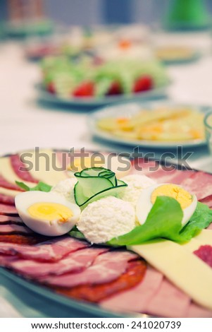 Arrangement of food and cakes - stock photo
