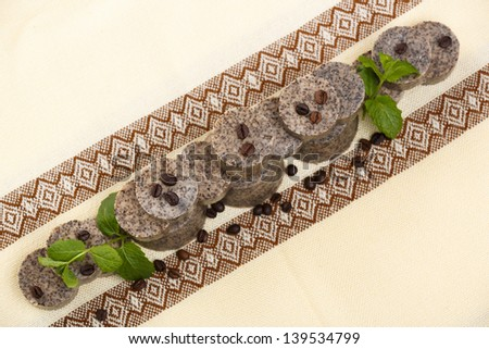 Arrangement of handmade flavored soap bars with coffee beans and green lavender leafs. - stock photo