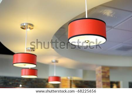 Arrangement of hanging lighting fixtures - stock photo
