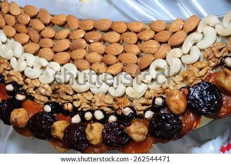 Arrangement of nuts and dried fruits - stock photo