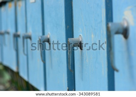 Arrangement of old blue cabinets - stock photo