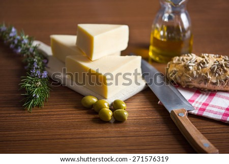 Arrangement of olive oil and cheese