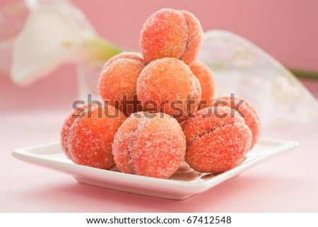 Arrangement of peaches shaped homemade cookies. - stock photo