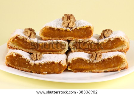 Arrangement of pumpkin pie slices with walnuts - stock photo