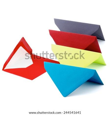 Arrangement of Red Envelope and Colored Paper Envelopes In a Row isolated on white background - stock photo