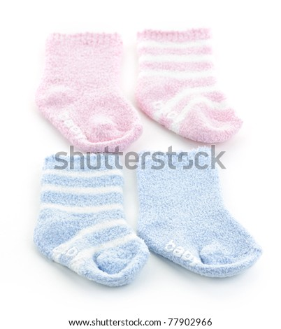 Arrangement of two pairs of infant socks for baby shower