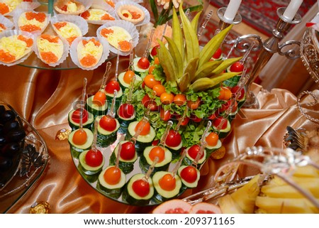 Arrangement of vegetable on party table - stock photo