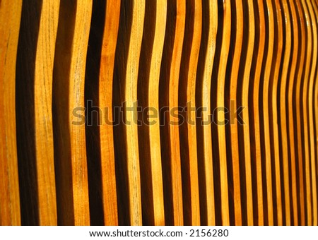 Arrangement of warm colored wood makes an excellent background.