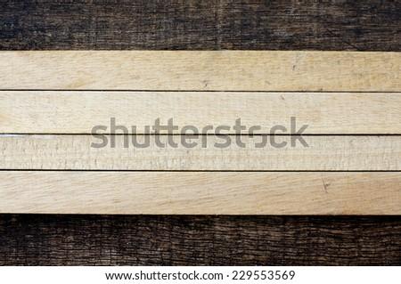 arrangement of wooden sticks on old wooden background - stock photo