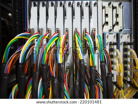 arrangement stack of colorful electronic cable wire socket hub in telecommunication control room  - stock photo