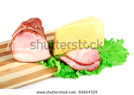 Arrangement with meat smoked bacon and cheese on Cutting board - stock photo