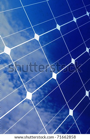 Array of blue solar cells with reflection of cloudy sky (detailed render) - stock photo