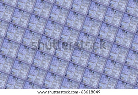 Array of CPU dies on a silicon wafer - stock photo