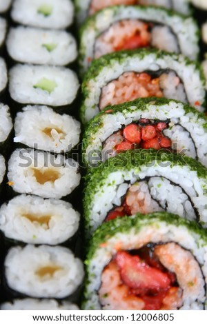 Array of sushi rolls all lined up - stock photo