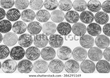 Arrays of Thai Baht money coins with hole from missing one coin - stock photo
