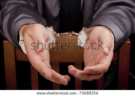 Arrest, arrested a man in handcuffs during the interrogation. - stock photo