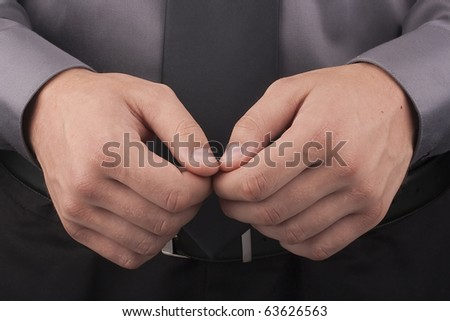 Arrest, close-up shot man's hands before they dressed handcuffs. - stock photo