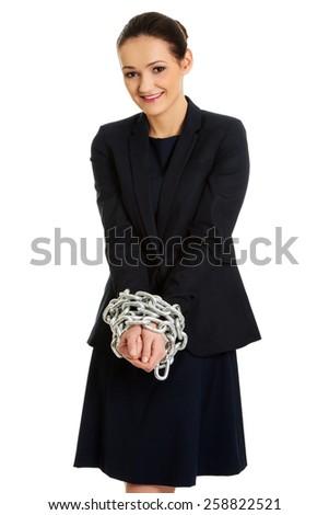 Arrested businesswoman with handcuffs around hands. - stock photo
