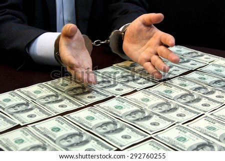 arrested for bribery. caught red-handed. bribe - Stock Image - stock photo