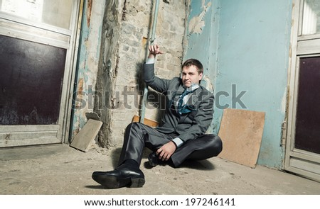 Arrested man with handcuffed hand - stock photo