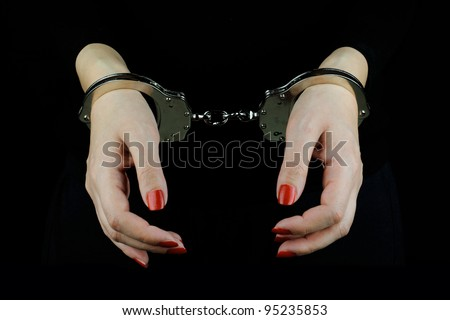 Arrested Woman - stock photo
