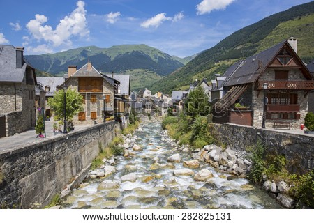 Arriu Nere (Black river) at his pass for Vielha in a spring day. Aran Valley, Lleida, Catalonia, Spain - stock photo