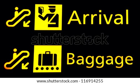 Arrival and Baggege signs at the airport - stock photo