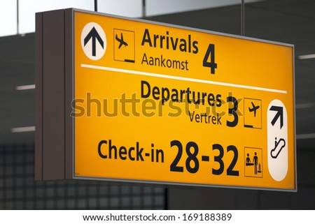 Arrival and departure information board at an airport. - stock photo