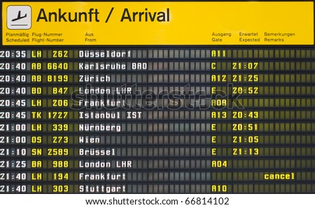 Arrival board at an airport in Germany - stock photo