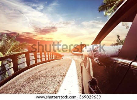arriving on car to the hot tropical beach - stock photo