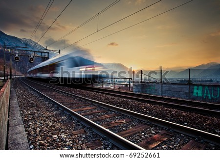arriving train on railway - stock photo