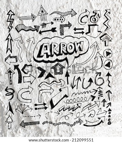 Arrow  and Hand drawn sketch arrows collection on wall texture background design