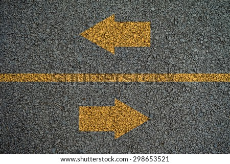 Arrow and line on the on Asphalt roads - stock photo
