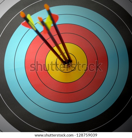 Arrow hit goal ring in archery target - stock photo