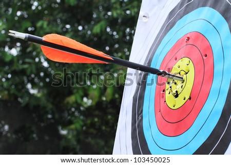 arrow hit target. - stock photo