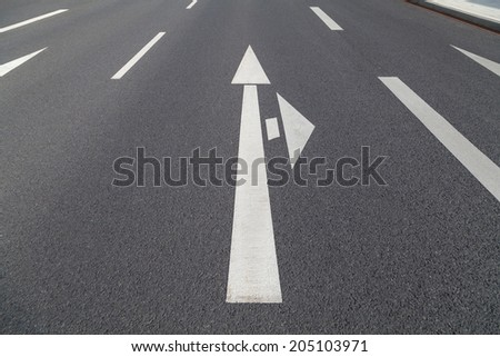 arrow in two directions on asphalt