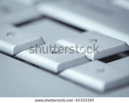 arrow keys on the computer keyboard,selective focus and blue toned, for navigation or computer themes - stock photo
