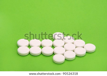 Arrow of Pills on green background