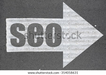 Arrow on asphalt road written word seo  .