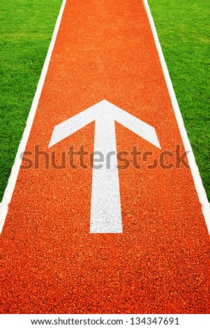 Arrow on athletics all weather running track