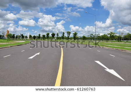 arrow on the road surface as blue sky - stock photo