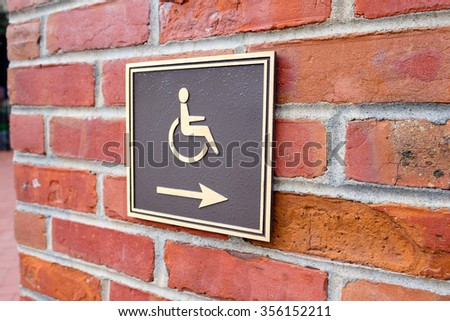Arrow points to the right for wheelchair access in San Francisco. - stock photo