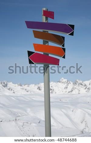 arrow post sign on ski slopes - stock photo