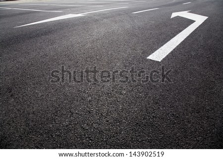 Arrow sign as road markings on a street