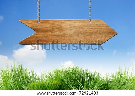 arrow sign on blue sky with clouds - stock photo